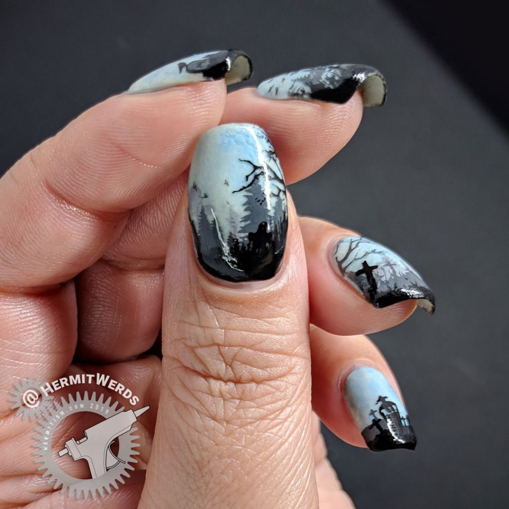 Glow in the dark haunted graveyard nail art with overlooking castle.