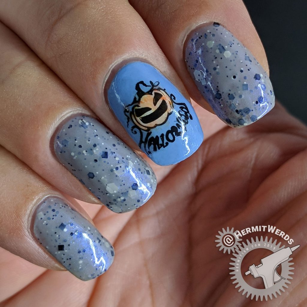 Grey crelly polish with blue jack-o-lantern nails colored in with watercolor paint.
