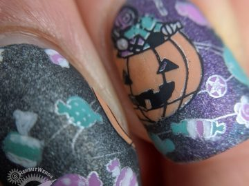 Black, purple, and teal holographic galaxy nail art with Halloween jack-o-lantern planet and space candy.