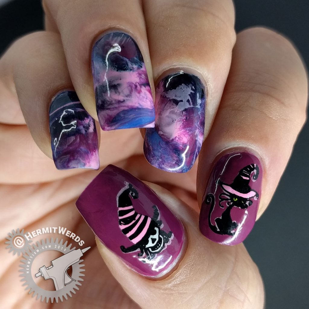 Purple, pink, and blue smoosh marble nail art with fabulously hat-ed witch and black cat familiar.