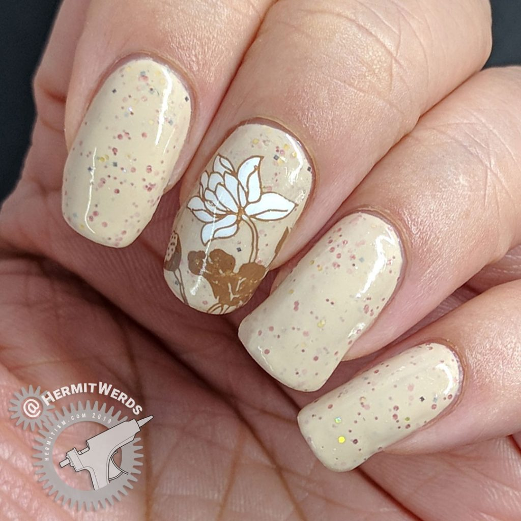 A soft crelly nail art in neutral shades with floral lily pad stamping.