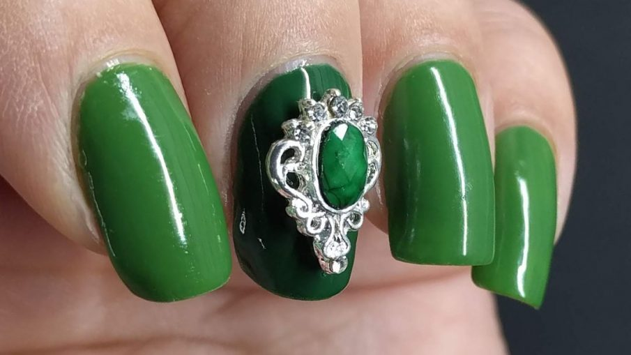 Super green nail art with a silver and green nail charm.