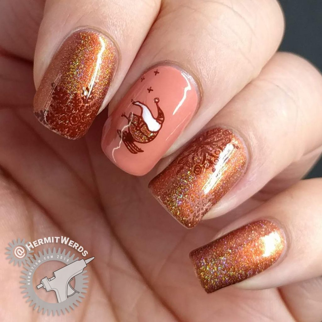 Adorable skiing Santa nail art with an orange holographic color scheme and snow flake stamps.