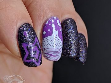 Dreamy purple glow in the dark nail art with a child stargazing on the back of a whale.