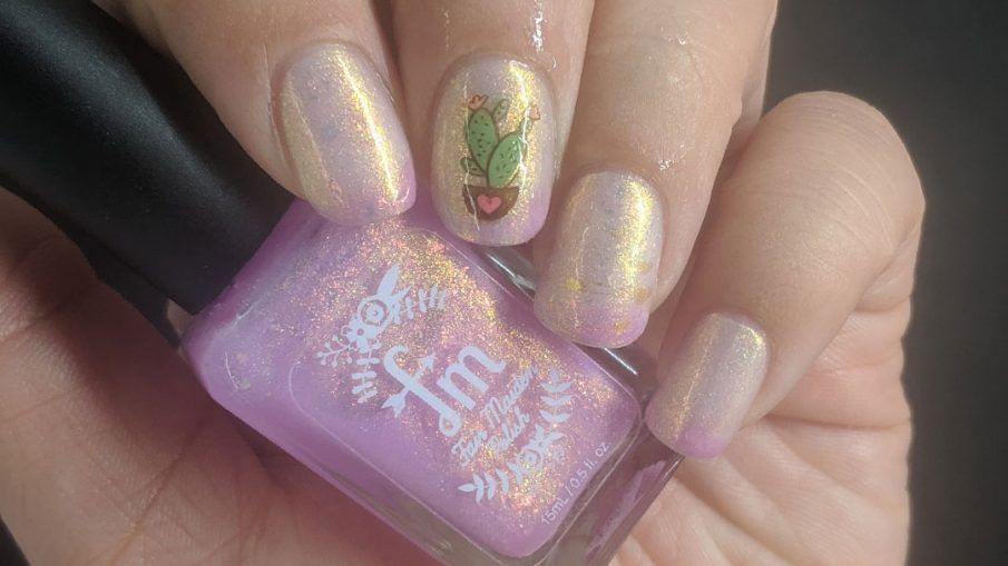 Pink and white thermal mani with adorable heart and cactus nail decals and gold shimmer.