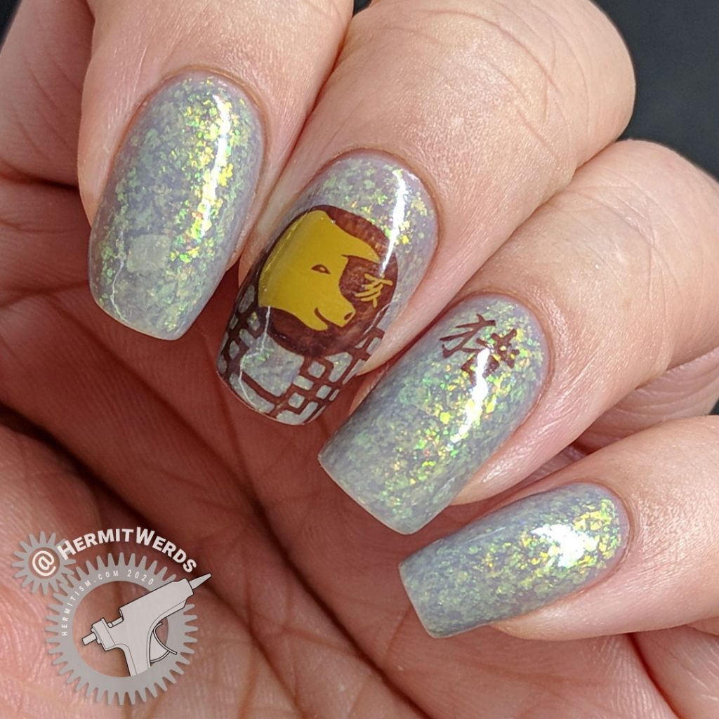 Year of the Pig nail art with pig stamping in all of the pig's lucky colors: brown, grey, and yellow.