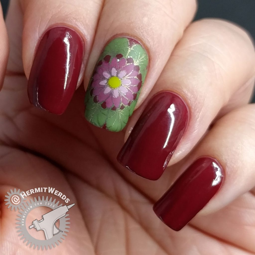 A deep red (merlot) nail art with a few brightly colored mandala decals.