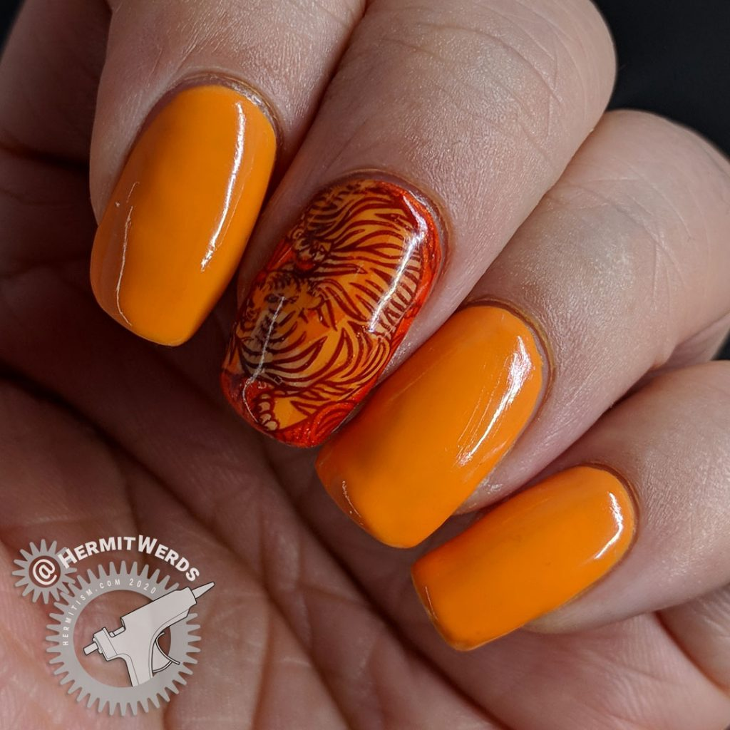 Orange nail art with a fierce tiger stamping decal inspired by Pantone's Orange Tiger color.