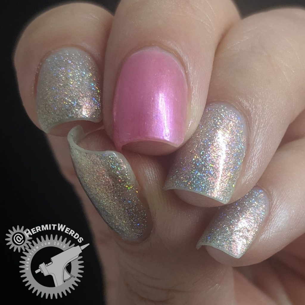 Pink holographic mani with a single pearly pink accent nail.