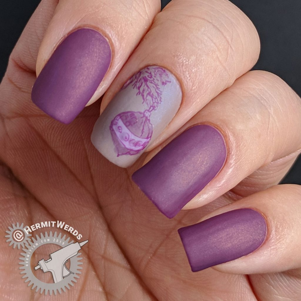 Matte purple nail art with an ornament hanging from a Christmas tree stamping decal.