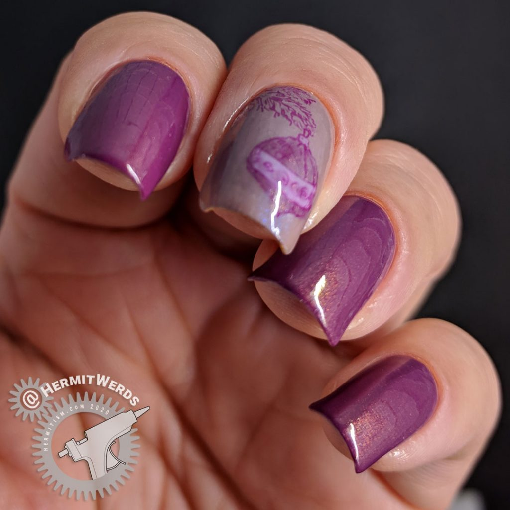 Purple monochrome nail art with an ornament hanging from a Christmas tree stamping decal.