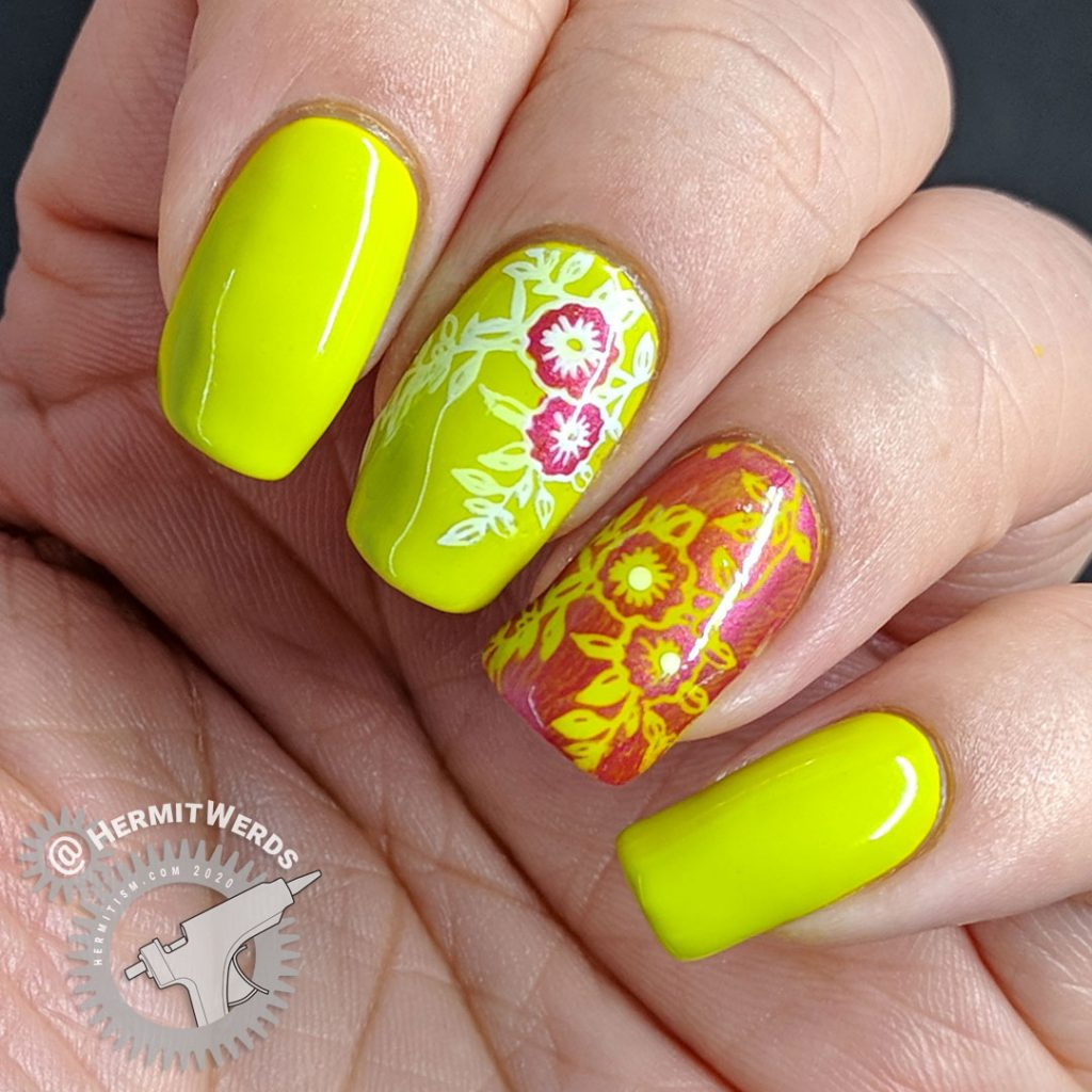 Bright green nail art with floral nail stamping in pink and white.