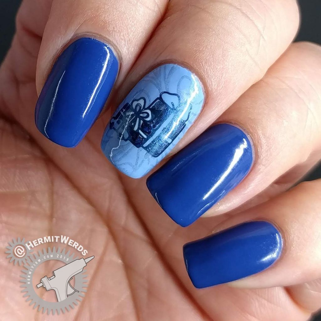 Blue monochrome nail art with Christmas presents and toys.