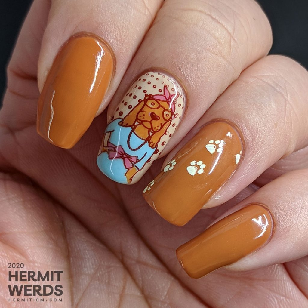 Hazel-colored nail art about walk your dog month with cute dog stamping images and paw prints.