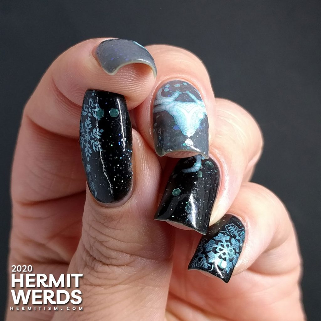 Cold, dark nail art with black and grey crellies filled with aqua hex glitter and the frosty white spirit of a deer.