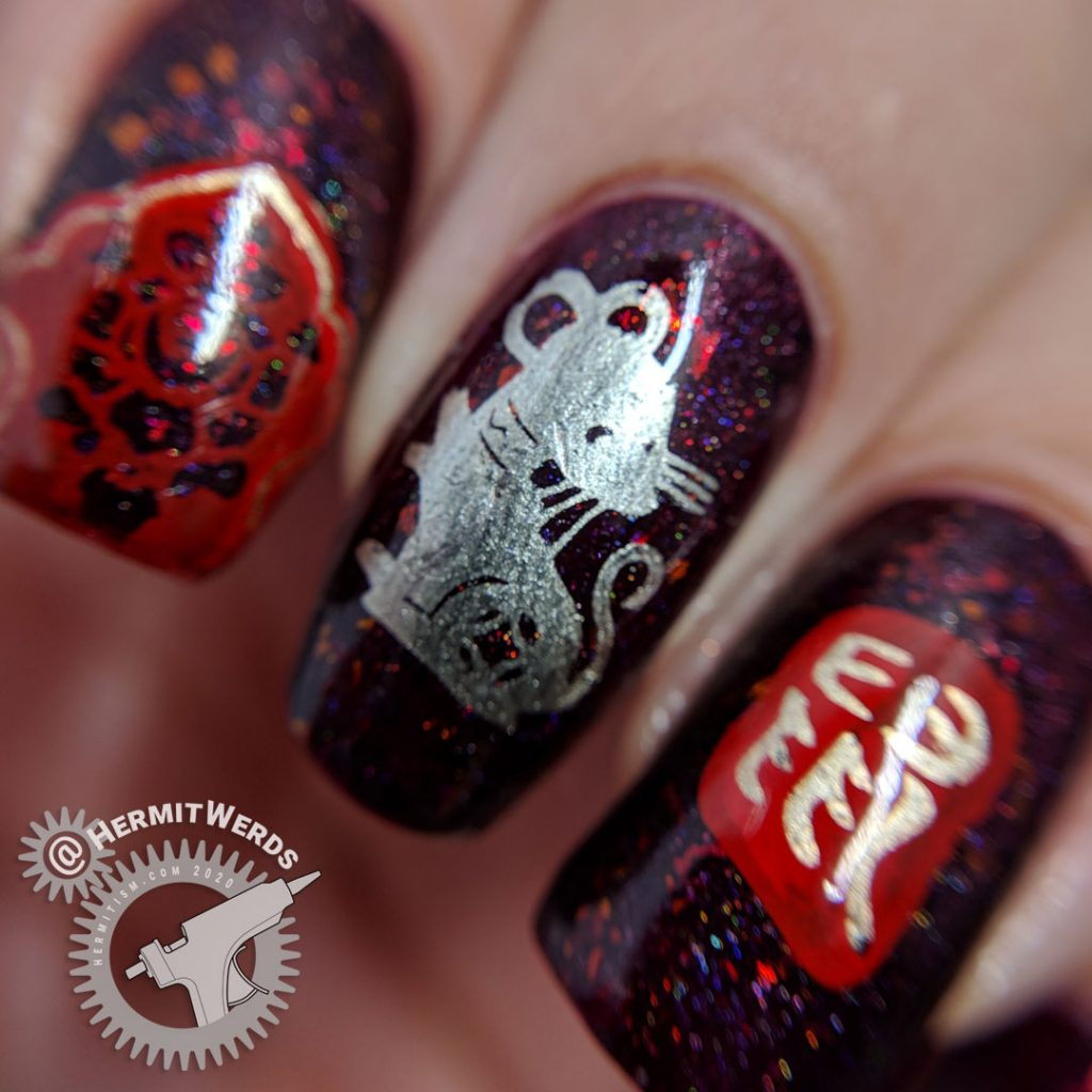 Year of the Rat nail art with a deep red base and Chinese paper cutting stamping images of rats.