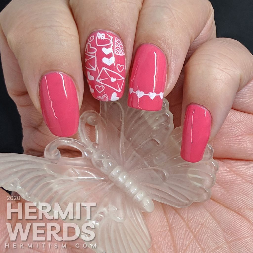 Simple and bright pink nail art with heart and love letters stamping decals.