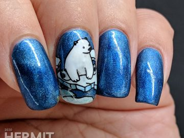 Classic blue magnetic nail art with adorable fish-loving polar bear stamping decals.