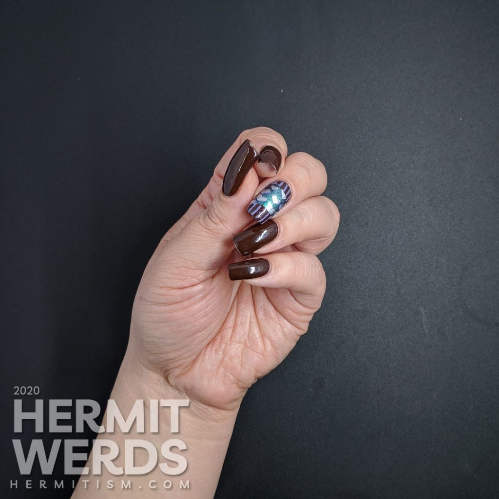 Chocolate-y heart nail art for Valentine's Day in non-traditional colors.