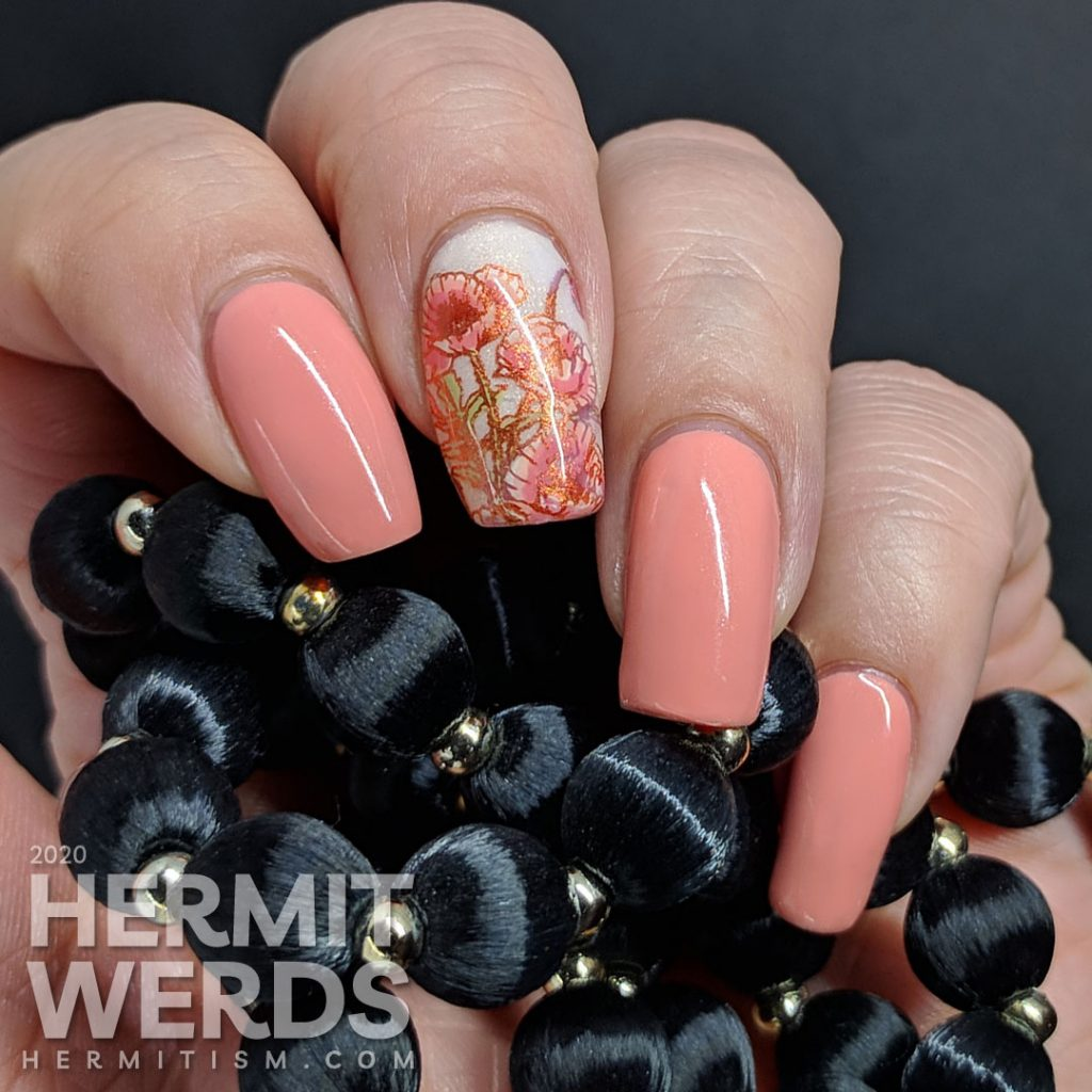 Soft peachy pink nail art with poppy reverse stamped accent nails.