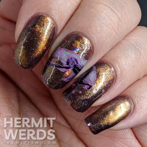 Coppery magnetic nail art with spirit animal wolf stamping images (or werewolf if that's how you see it).