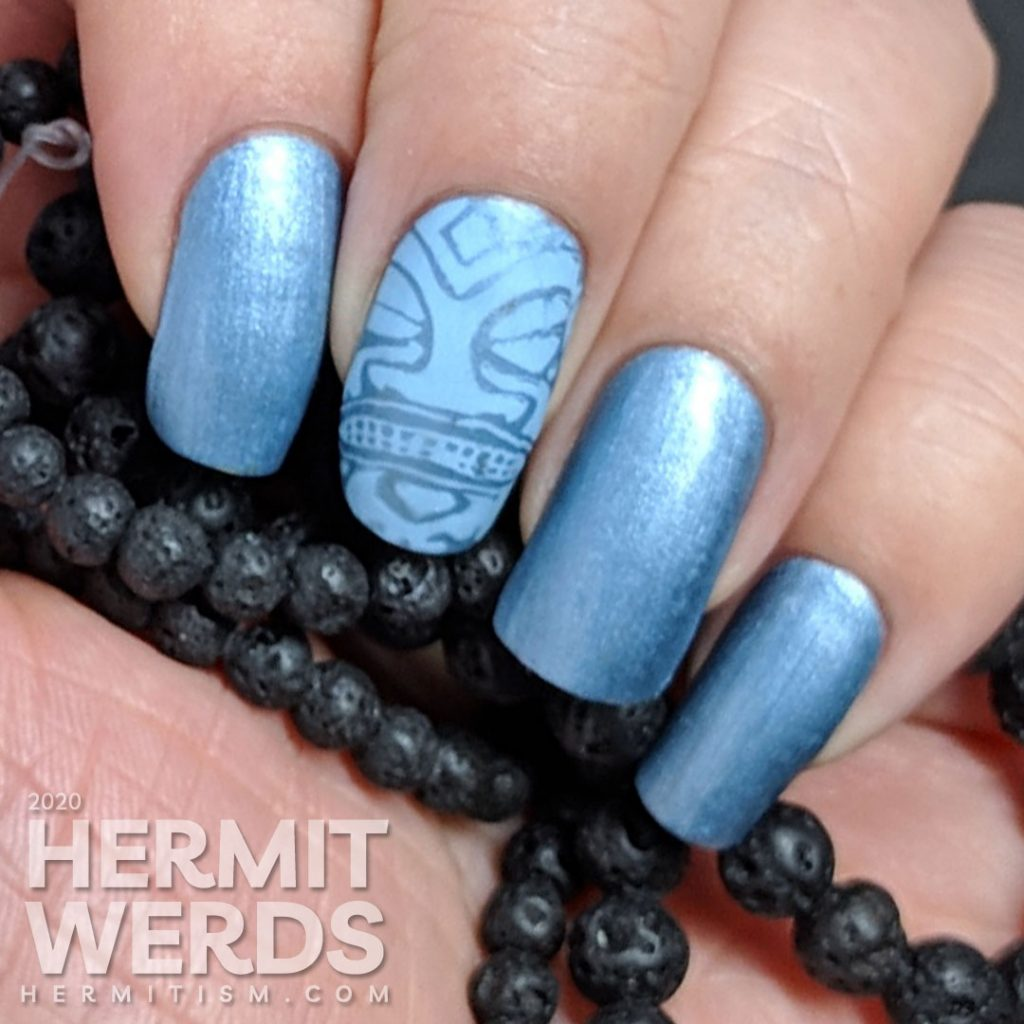 Blue metallic nail art with tribal stamping decals in a light blue.
