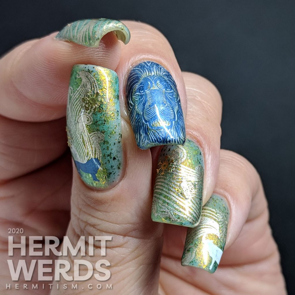 Medium green nail art full of windy patterns and a bold winter lion slowly turning into a gentle white lamb.