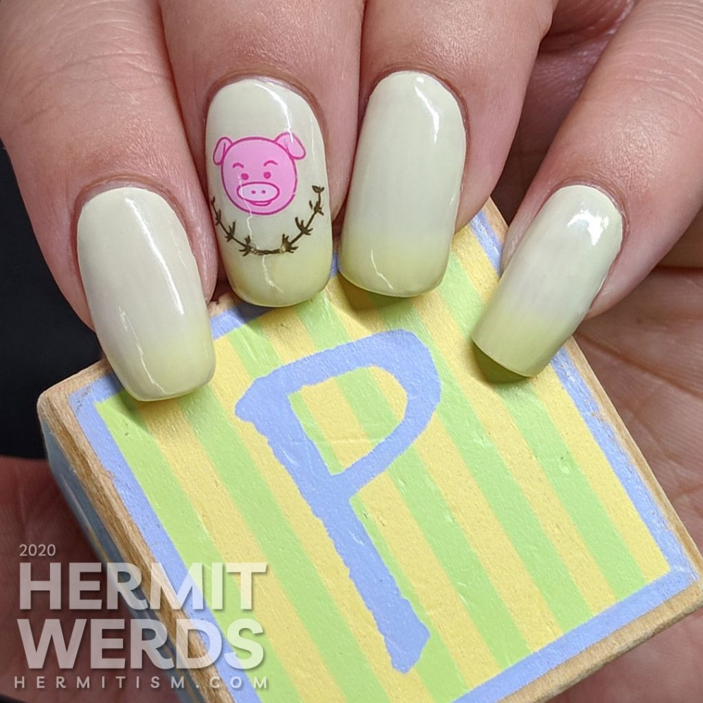 Green thermal nail art with cute pigs stamped on top.