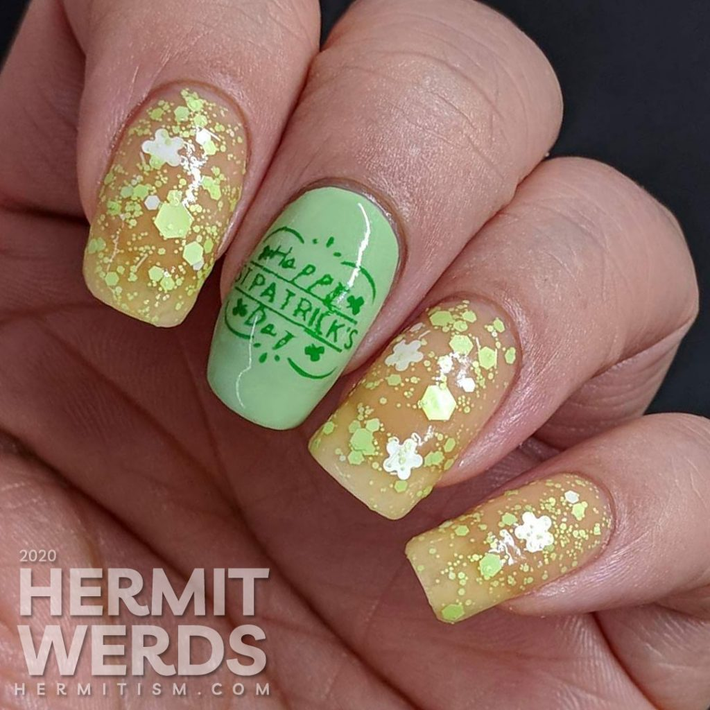 Seemingly green St Patrick's Day nail art with clover which has a pink thermal polish secret.