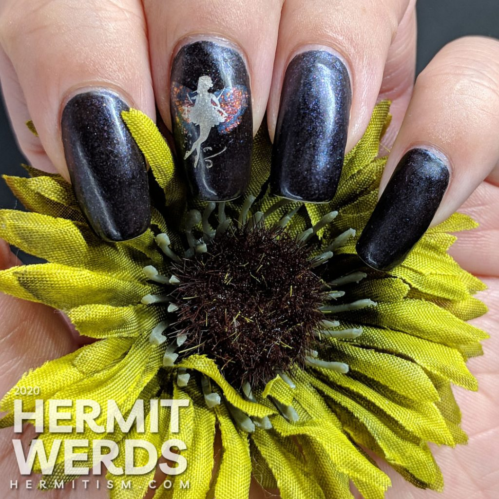 A dark purple mani with a silver fairy with butterfly wings stamped on top.