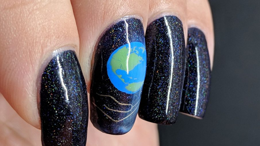 Holographic Earth Day nail art of the Earth being cradled in a human hand.