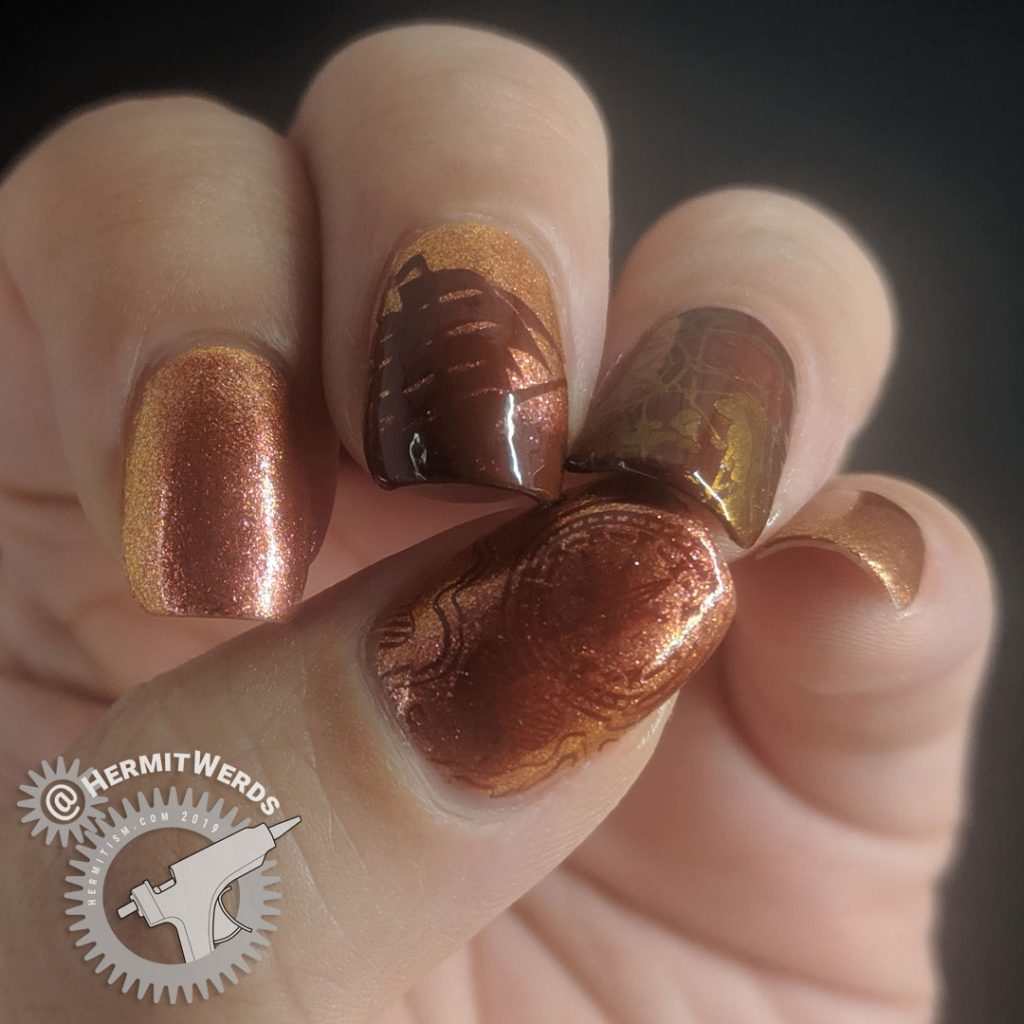 Orange duochrome polish with pirate ship and map stamping decals for Talk Like a Pirate day.