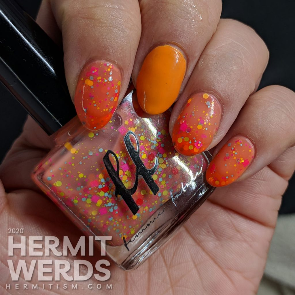 "Femme Fatale's ""Sour Gummies"" orange to nude thermal crelly polish with yellow, orange, blue and pink glitters."