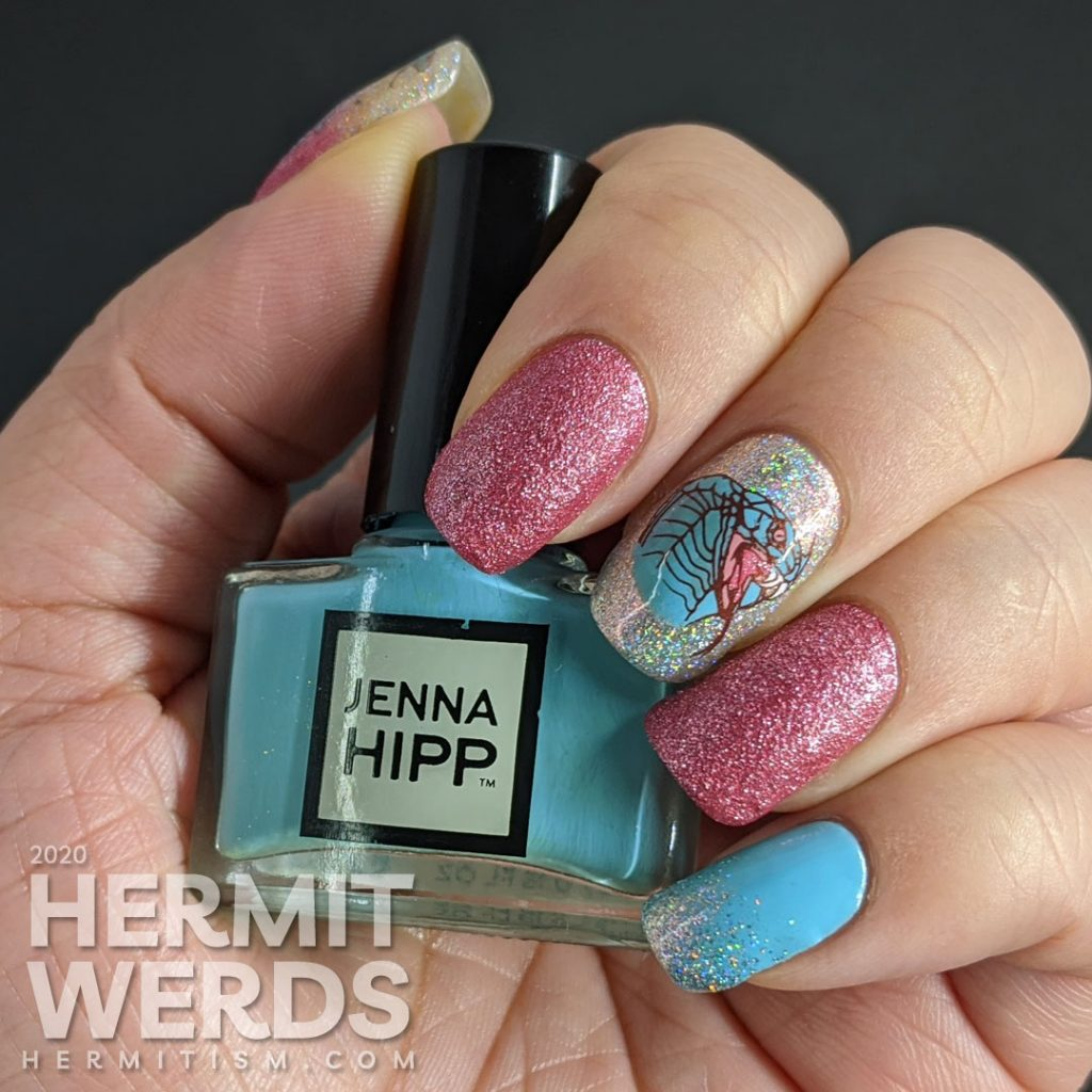 A soft pink and blue nail art decorated with hooded cobra stamping decals and a little dash of the holographic.