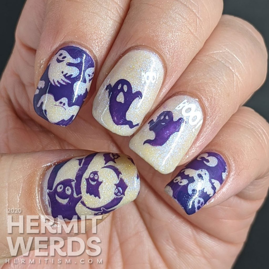 A white and purple ghostly nail art with negative space stamping, boo-ing ghosts and glow in the dark action!