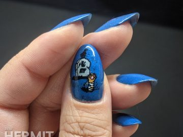 True blue nail art decorated with a rising zombie cat and glow in the dark ghost cat.