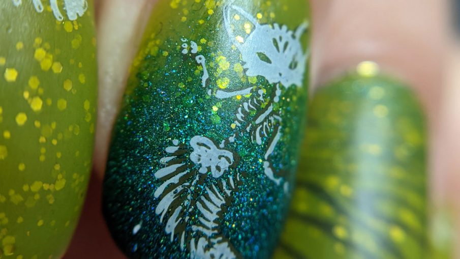 Pugly green nail art with skeletal mermaid cat double stamping decals and a teal to green gradient.