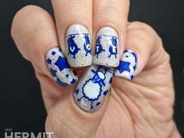 "A patriotic red white and blue crelly polish with blue sheep stamped on top and ""vote"" painted letter by letter on their fluffy sheep bellies."