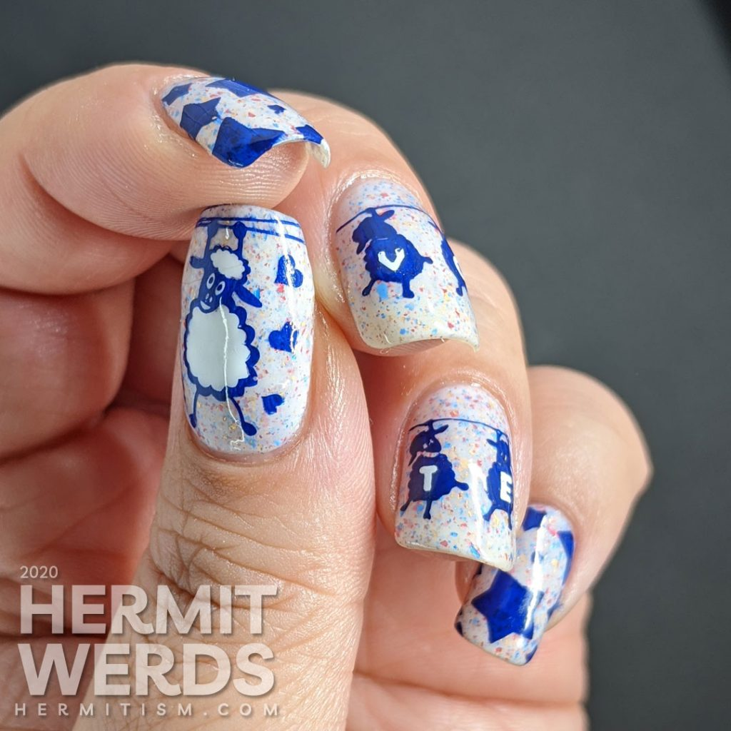 """A patriotic red white and blue crelly polish with blue sheep stamped on top and """"vote"""" painted letter by letter on their fluffy sheep bellies."""