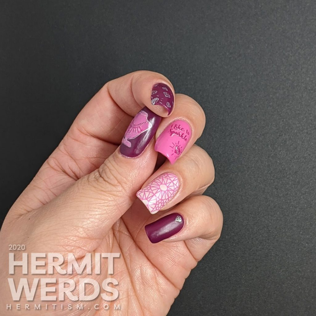 """Diamond themed nail art in pinks and purples with an iridescent white crelly accent nail that is covered in faceted gem stamping. """"I like to sparkle."""""""
