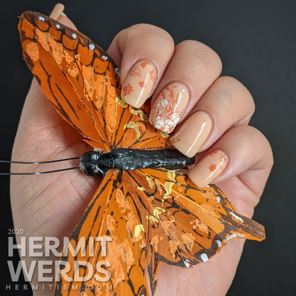 A simple fall nail art with stampings of leaves, pumpkins, and other harvest-related items on an apricot jelly polish background.
