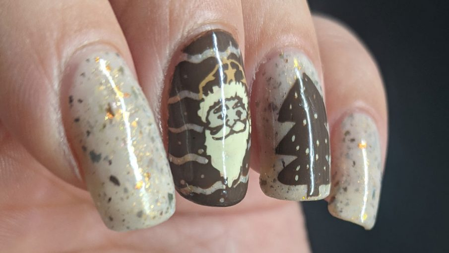 Nail art with Christmas imagery: Santa, Christmas tree, and Santa's sleigh taking off in a shower of stars on a light tan flakie-filled base.