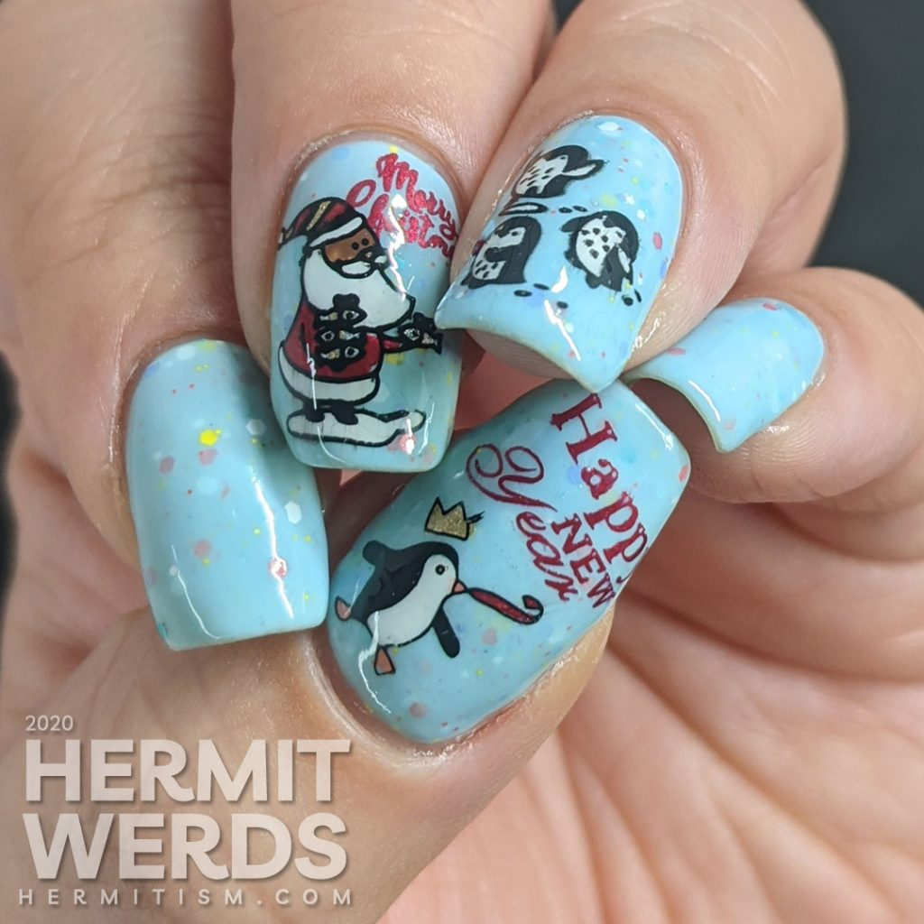 Nail art of Santa handing out fishy presents to cute penguins for Christmas and another penguin celebrating New Years on a blue crelly background.