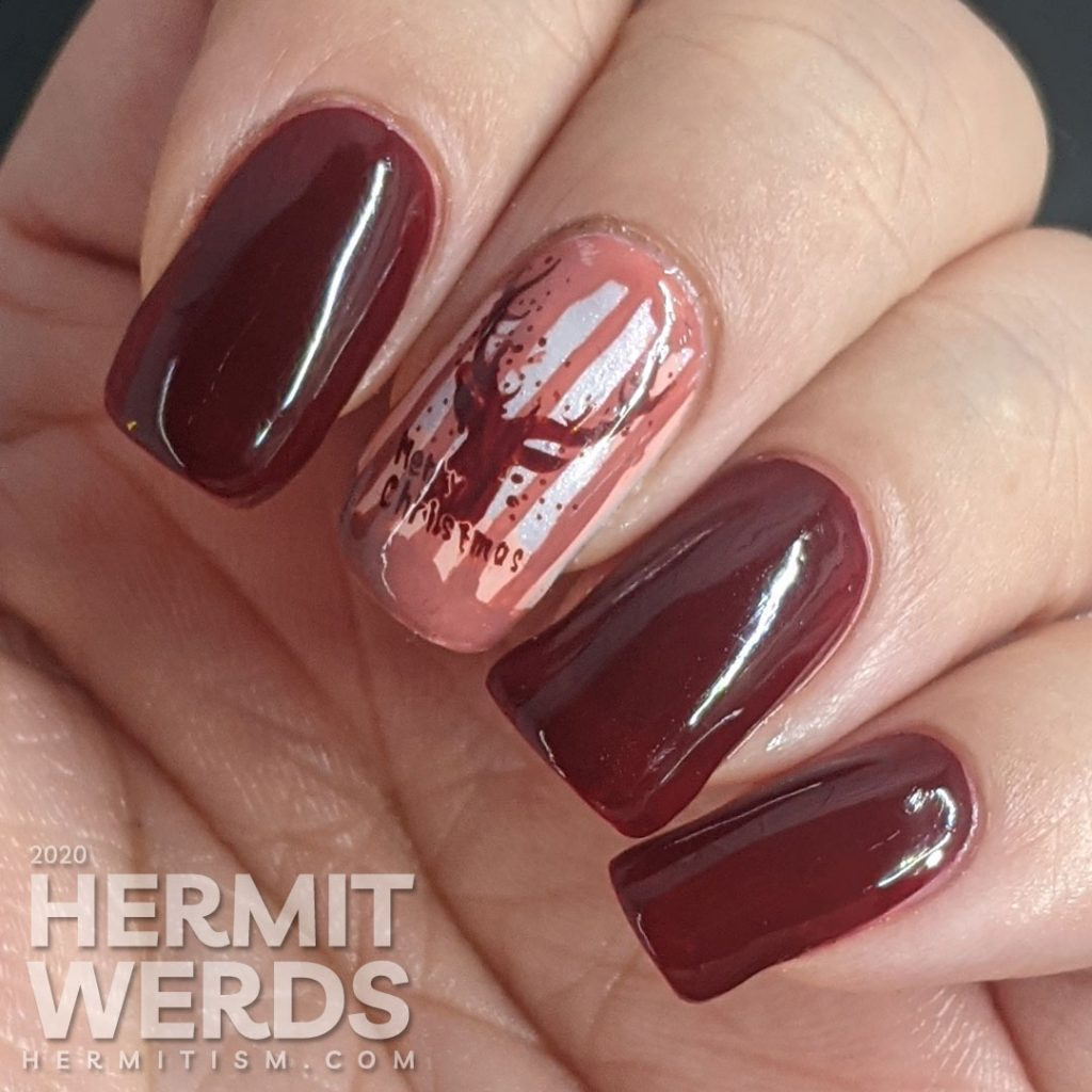 Monochrome red reindeer nail art with deep red polishes and a wintery scene created from layered stamping. Merry Christmas!
