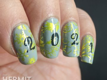 "A New Years mani with a grey background, bright green stamping of winter/spring/summer/fall seasons and ""2021"" on top."