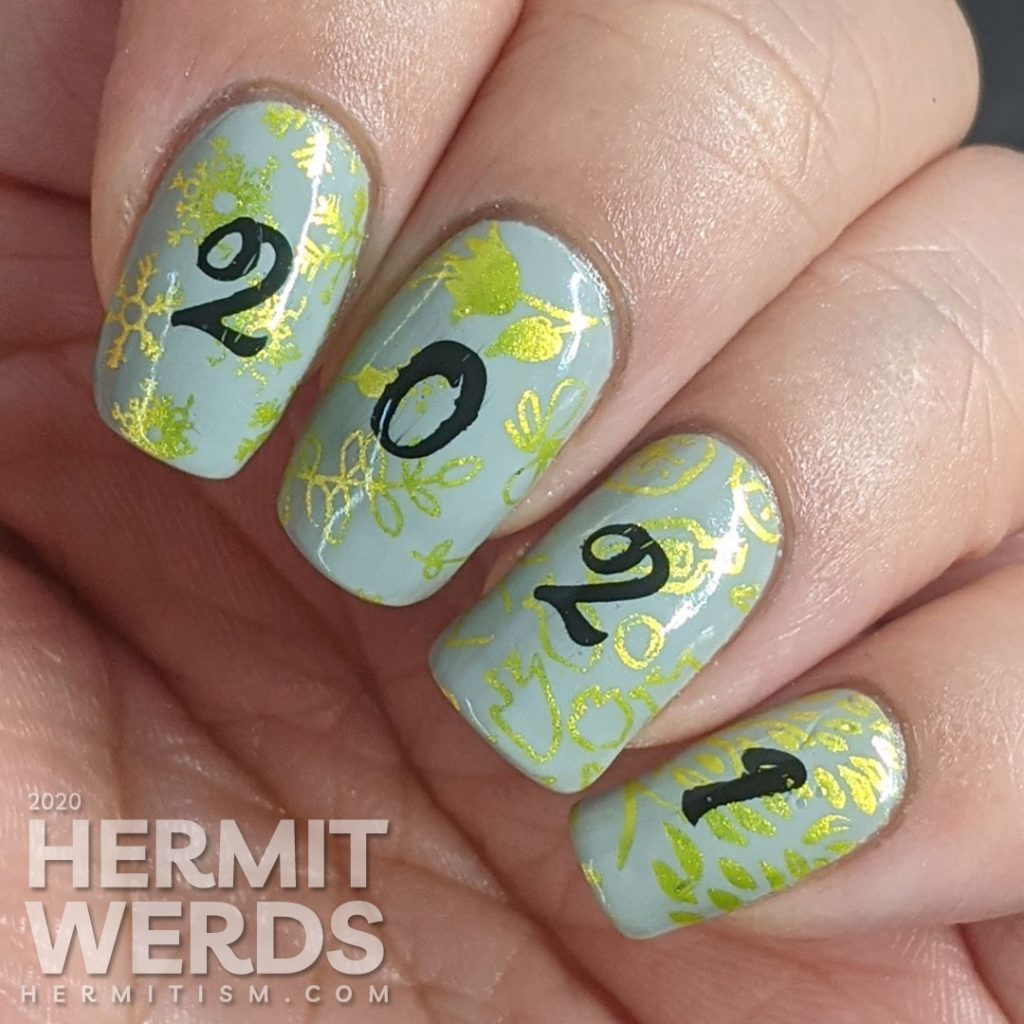 """A New Years mani with a grey background, bright green stamping of winter/spring/summer/fall seasons and """"2021"""" on top."""