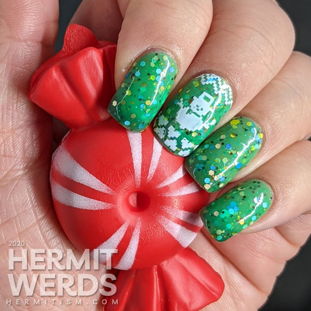 """Nail art with blocky sweater pattern stamping on top of a super """"tacky"""" light green to ultramarine green tri-thermal indie polish stuffed with glitter."""
