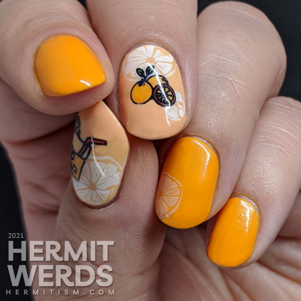 Fruit-themed bright orange nail art with orange slice and orange stamping decals on top.