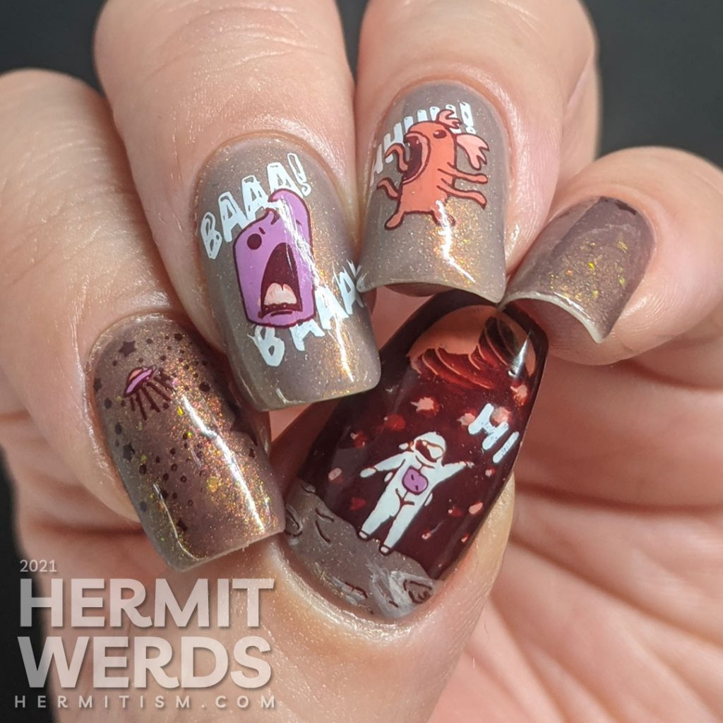 """A muted red nail art with a science fiction theme. Cute aliens stamping decals scream at each other while an astronaut says """"hi""""."""