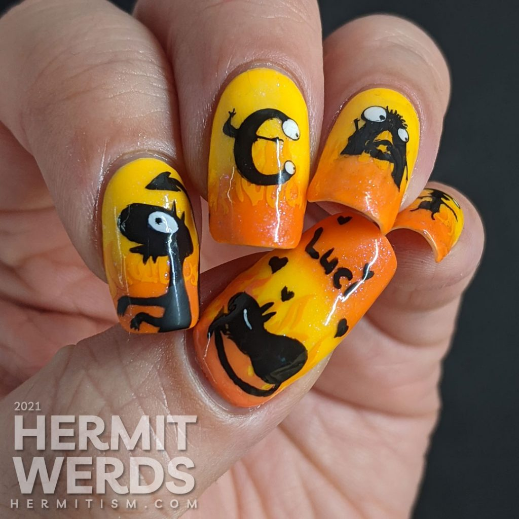 Yellow and orange nail art with the demon Luci (cat) from Netflix's Disenchanted freehand painted on top of flames.